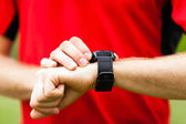 Runner looking at sport watch — Stock Photo