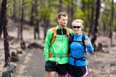 Couple hiking in forest — Foto Stock