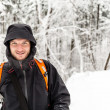 Man hiking in winter forest — Stock Photo