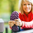 Woman runner exercising and stretching, autumn nature outdoors — Stock Photo #33701569