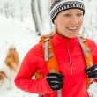 Stock Photo: Womhiking in winter with dog