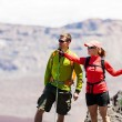 Stock Photo: Couple hikers in high mountains