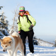 Woman winter hiking with dog — Stock Photo