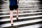 Man running on stairs, jogger — Stock Photo