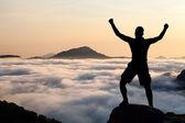 Man hiking climbing silhouette in mountains — Stock Photo