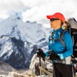 Stock Photo: Woman hiking in mountains