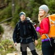 Couple happy hikers walking in mountains — Stock Photo