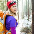 Woman hiking in winter forest — Stock Photo