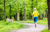 Woman running in summer park — Stok fotoğraf