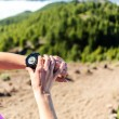 Trail runner looking at sport watch — Stock Photo #46532831
