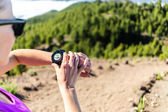 Trail runner looking at sport watch — Stock Photo