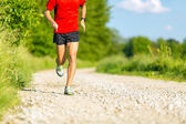 Man running on country road — Stock Photo