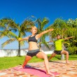 Woman and man doing yoga outdoors — Stock Photo #47841249