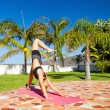 Woman doing yoga beautiful outdoors — Stock Photo #47841299