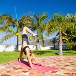 Woman doing yoga beautiful outdoors — Stock Photo #47841299