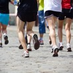 Running in marathon on city street — Stock Photo #6463797