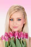 Portrait of a beautiful woman with tulips — Foto de Stock