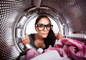 Young woman doing laundry View from the inside of washing machine. — Stock Photo