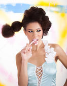 Beautiful afro-american woman with lollipop — Stock Photo