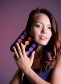 Young woman with beauty cosmetics — Stock Photo