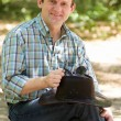 Man in the park with a cowboy hat — Stock Photo
