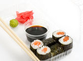 Sushi on a plate with sauce — Stock Photo