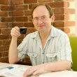 Happy aged man with coffee in cafe — Stock Photo