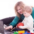 Mother and baby boy viewing the computer and smiling — Foto Stock
