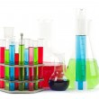 Different laboratory glassware with color liquid isolated on white — Stock Photo