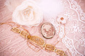 Women's accessories on a pink lace — Stock Photo