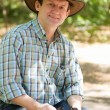 A man in a cowboy hat — Stock Photo