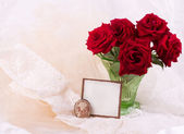 Bouquet of red roses with a white card on a white background — Stock Photo