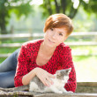 Royalty-Free Stock Photo: Beautiful young girl in the park with a cat