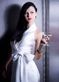 Beautiful young girl with glass of martini — Stock Photo