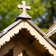 Fragment of a wooden roof with a cross — Stock Photo
