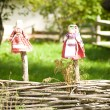Doll on a wooden fence in the village — Foto Stock