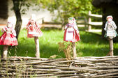 Doll on a wooden fence in the village — Stock Photo