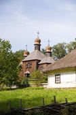 Old wooden church in the village — Stock Photo