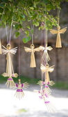 Angel-shaped handmade decoration made of straw — Stock Photo