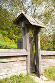 Opened wooden gate — Stock Photo
