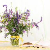 Beautiful spring flowers in a glass vase with banner add frame — Stock Photo
