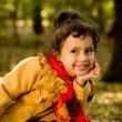 Funny little girl in autumn forest — Stock Photo