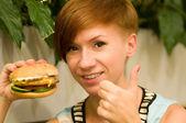 Woman with hamburger — Stock Photo