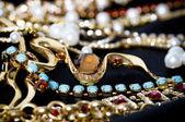 Tło złotej biżuterii — Zdjęcie stockowe