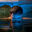 Young man posing in the swimming pool — Stock Photo