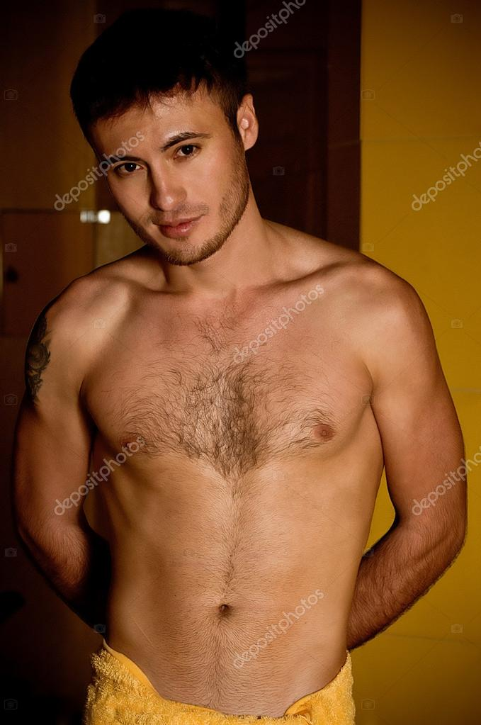 Handsome man with a towel on his hips — Stock Photo #15991809