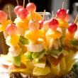 Fruit canape on toothpick — Stock Photo #16228469