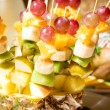 Fruit canape on toothpick — Stock Photo #16228475