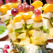 Fruit canape on toothpick — Stock Photo #16228491