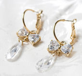 Jewelry earrings on the white background — Stock Photo